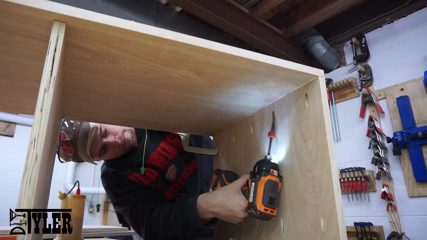 Putting the cabinet side in place